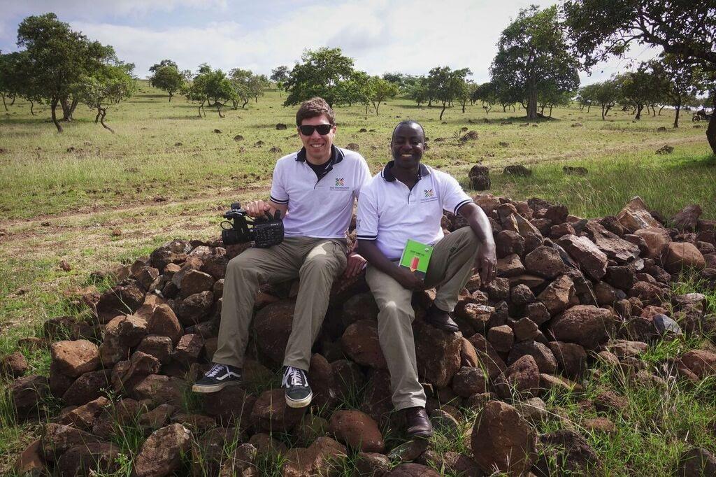 Tommy and FAE Founder Samwel Mfanga in Kisima Cha Mungu, a rural Masai community south of Arusha, Tanzania.