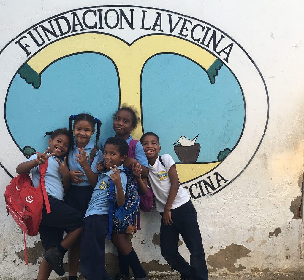 Kids 3rd grade in front of La Vecina logo