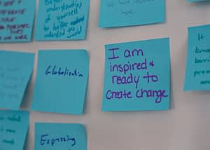 sticky note that says 'I am inspired and ready to create change'