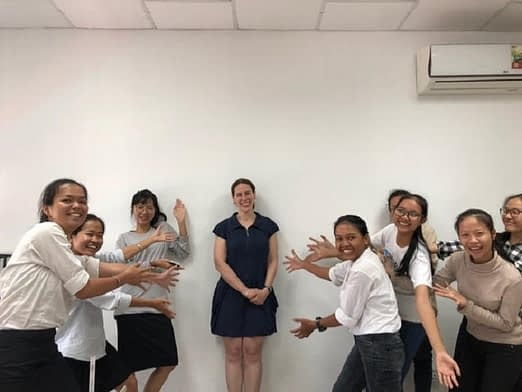 Volunteer Leanne posing with WEduShare students in Cambodia