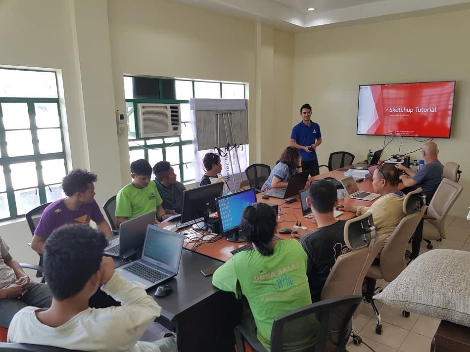 Stephen leading an AutoCAD teaching session with AIDFI team in Philippines
