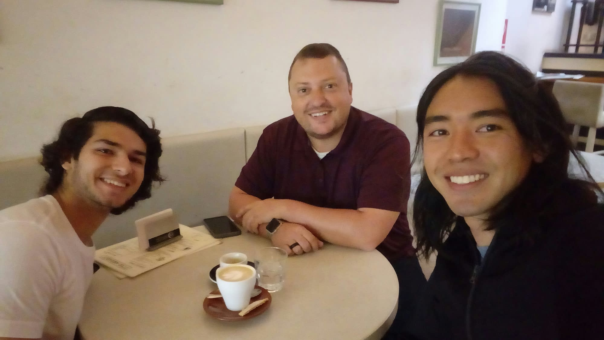 Pepe, Varun, and Jeremy at a coffee shop tasting local coffee.