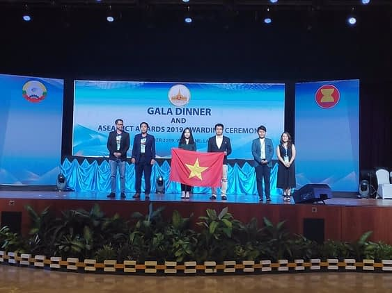 Representatives from HOCMAI on stage being honored at the ASEAN ICT Awards gala dinner