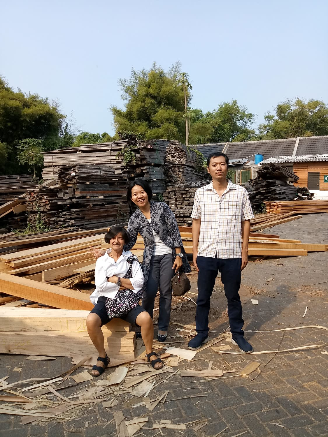 Marina exploring the sawmill and discussing a sustainable new product.