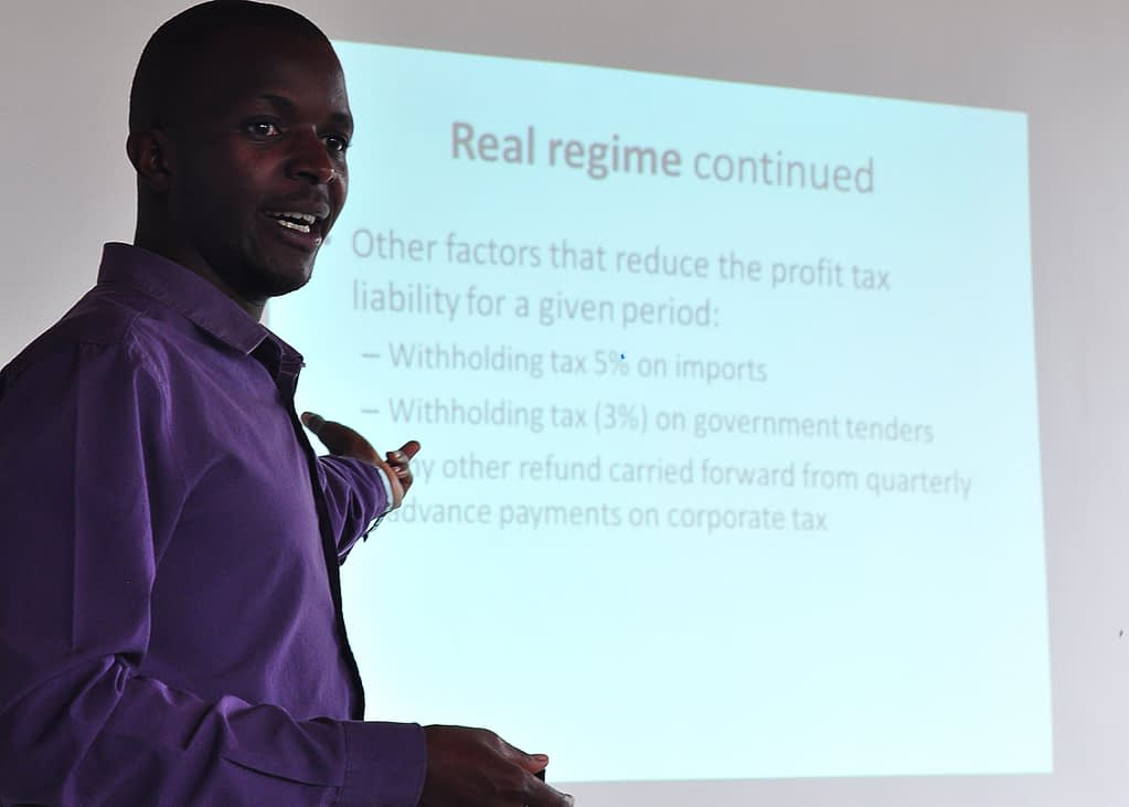 Osman Senyonjo, a business development associate and taxation expert gives a training to Rwanda entrepreneurs at AEC's offices in Kigali.