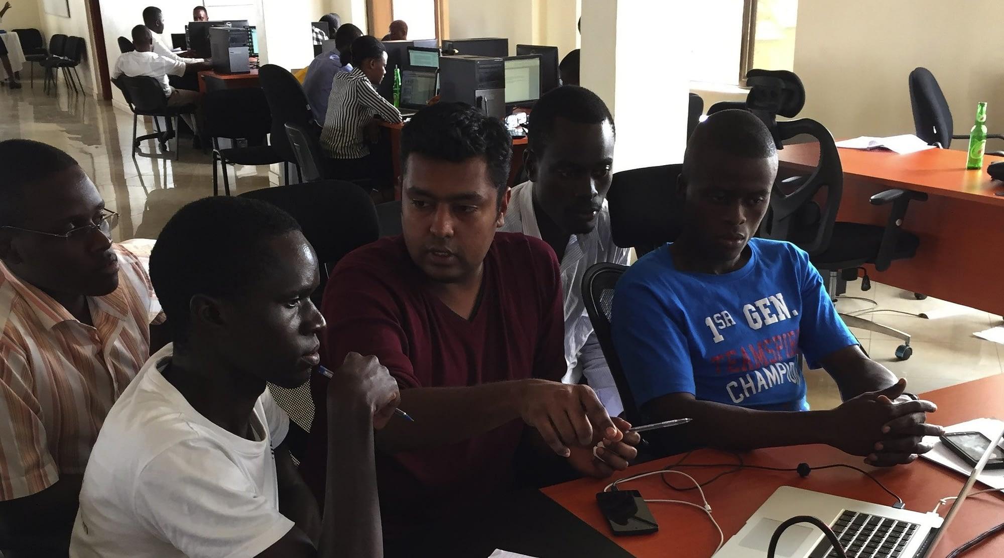 Microsoft developer Anand Mariappan, center, works with local tech-startup employees in Kampala, Uganda as part of Microsoft's International Skills-based Volunteering Program - MySkills4Afrika (Mariappan)