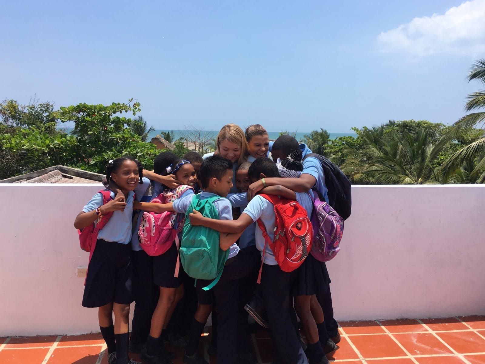 Emilia and group hug with kids 5th grade