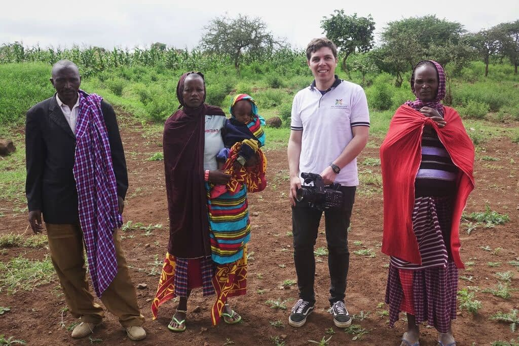 Tommy with the Enjoro village leader and two mothers. In collaboration with FAE, they are working to bring a small health clinic to Enjoro so that women don't have to travel 90+ minutes on a dirt road to give birth in a safe facility.