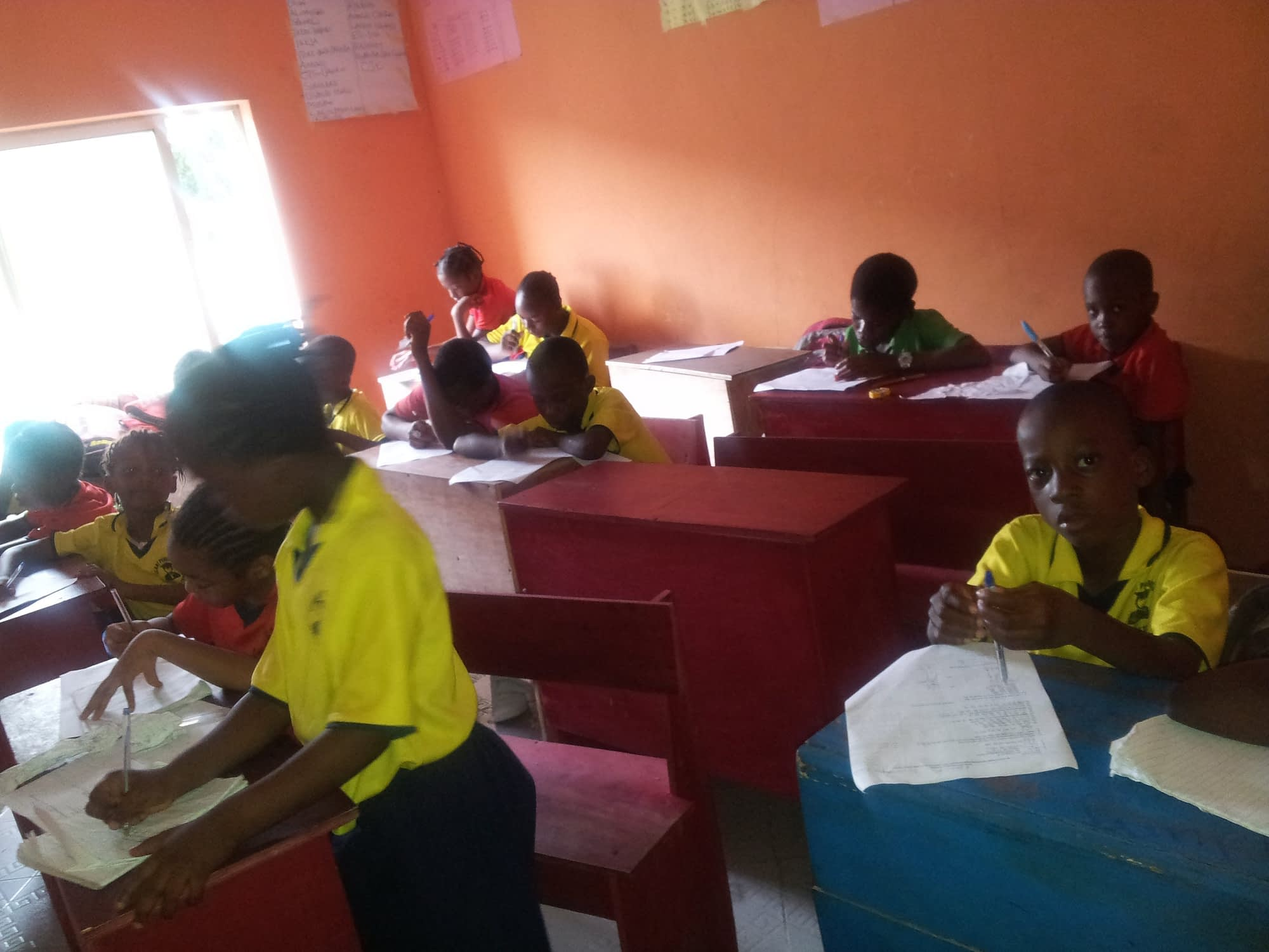 Students eagerly learning at the school.