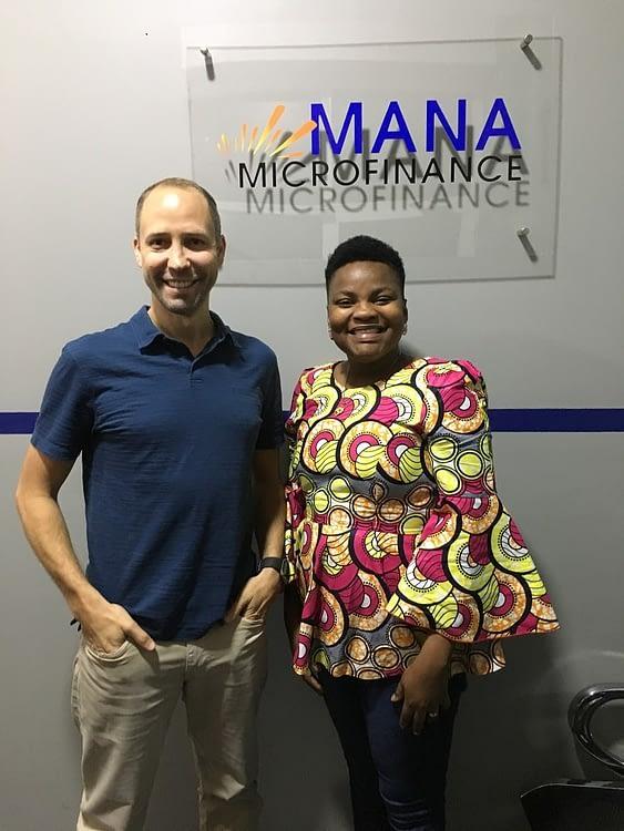 Mana Microfinance founder with volunteer Darren