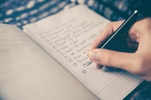 Writing SMART goals in notebook