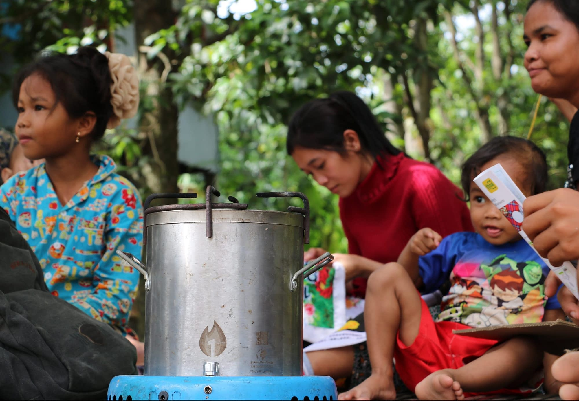 A family with their new cookstove.